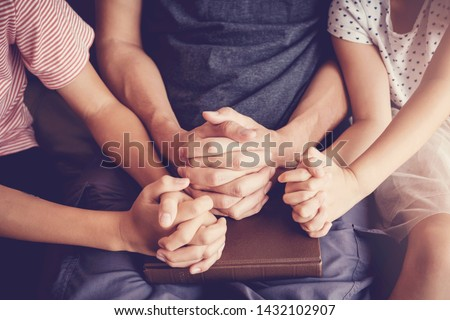 Children praying with their father parent at home, family and kids pray, praying hands, online group worship, World Day of Prayer,international day of prayer, hope, gratitude, thankful, trust concept Royalty-Free Stock Photo #1432102907