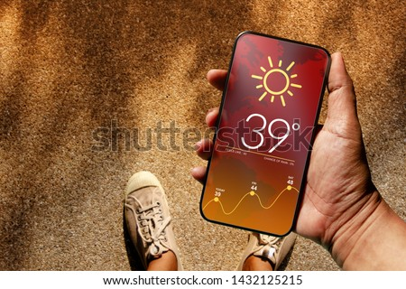 Ecology and Technology Concept. High Temperature Weather show on Mobile Screen on Hot Sunny Day. Top View, Grunge Dirty Concrete Floor with Sunlight as background Royalty-Free Stock Photo #1432125215