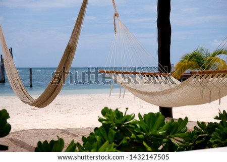 Hammock On A Cancun Beach With Soft White Sand and Blue Sky with White Wispy Clouds. A Beautiful Cancun Vacation Scene To Relax and Let The Stress Slip Away. #1432147505