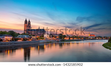 Magdeburg, Germany. Panoramic cityscape image of Magdeburg, Germany with reflection of the city in the Elbe river, during sunset. #1432185902