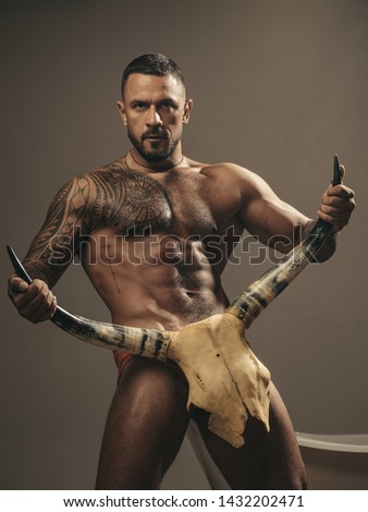 sport and fitness, health. brutal sportsman hold animal skull. steroids. muscular macho man with athletic body. sexy abs of tattoo man. male fashion. confidence charisma. nude male body. seduction. #1432202471