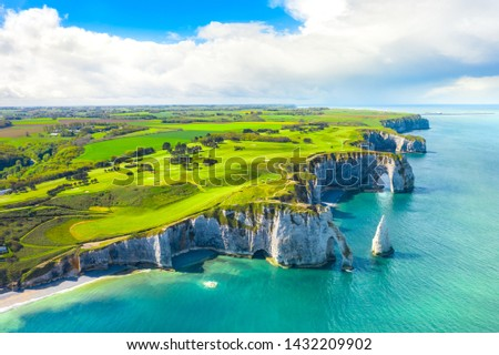 Picturesque panoramic landscape on the cliffs of Etretat. Natural amazing cliffs. Etretat, Normandy, France, La Manche or English Channel. Coast of the Pays de Caux area in sunny summer day. France  #1432209902