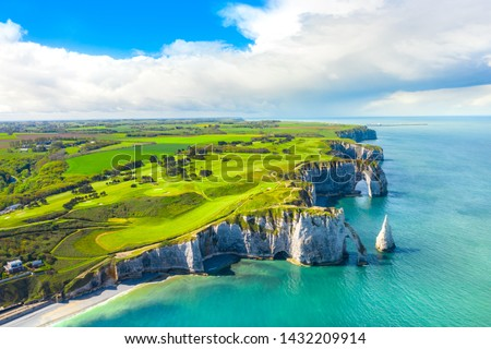 Picturesque panoramic landscape on the cliffs of Etretat. Natural amazing cliffs. Etretat, Normandy, France, La Manche or English Channel. Coast of the Pays de Caux area in sunny summer day. France  #1432209914