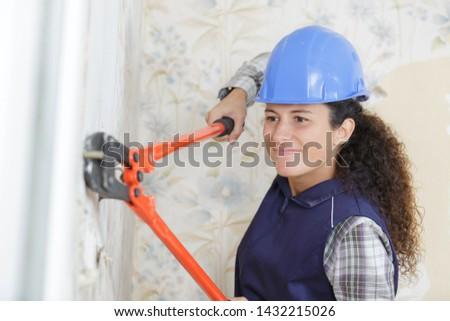 worker woman with scissors mower #1432215026