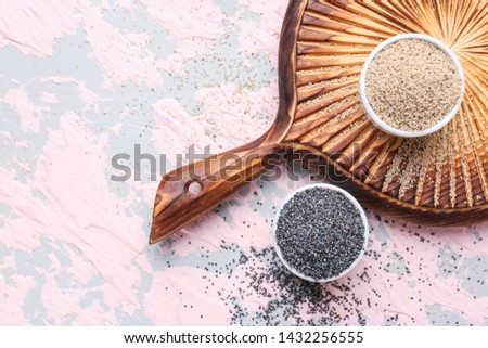Bowls with different poppy seeds on color background #1432256555