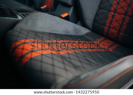 Modern car fabric sport seats with red stripes Royalty-Free Stock Photo #1432275950