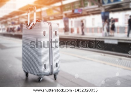 Sillver Suitcases or baggage at blurred of sky train station platform with network line for connected world wide of transport. Trip vacation or holiday tourism by bts city rail in Bangkok Thailand. #1432320035