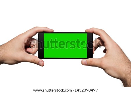 Smartphone in Hands With Green Screen For Copy Space Isolated On White Background