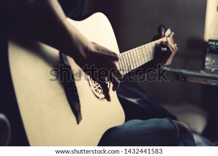 Harbin, Heilongjiang, China. A college student is playing his guitar. #1432441583