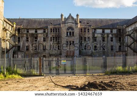 Hartwood Hospital, abandoned psychiatric asylum, Nurses Home. Derelict of 3-storey U-plan, Baronial-style nurses residential home. Lanarkshire, Scotland Royalty-Free Stock Photo #1432467659