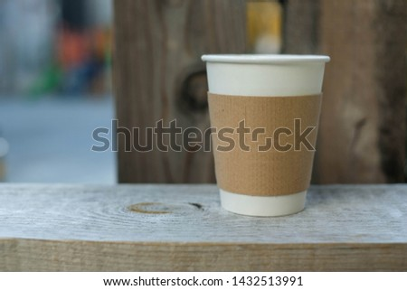 Paper Coffee Cup on the Stone Wall #1432513991