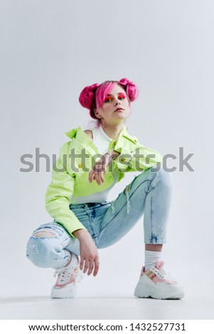 woman with pink hair sitting