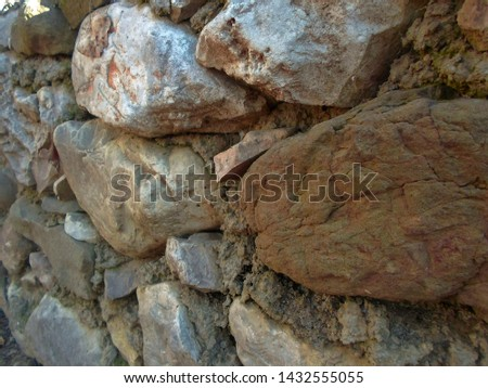pattern of decorative multicolored sand stone wall surface, background, texture #1432555055