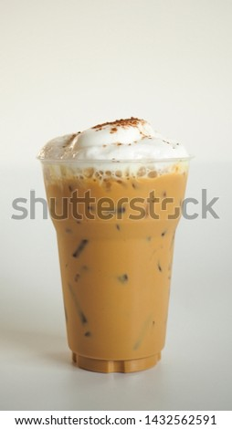 Iced cappuccino coffee  in takeaway cup and milk foam isolated on white background, macro. #1432562591