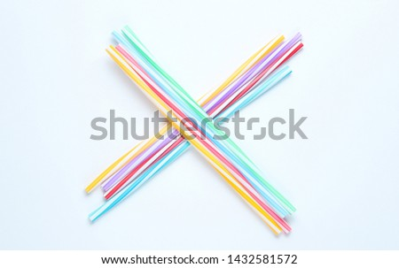 Lot of multi-colored cocktail tubes on white background. Top view #1432581572