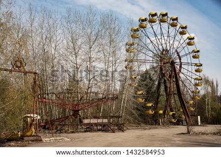 Old ferris wheel in the ghost town of Pripyat. Consequences of the accident at the Chernobyl nuclear power plant #1432584953