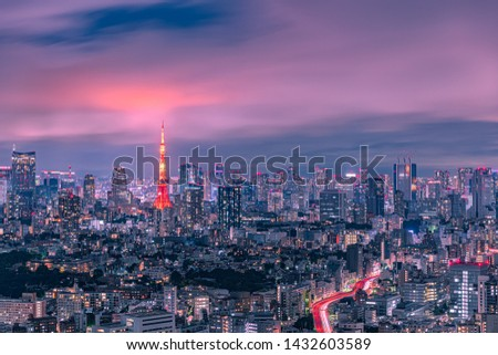 Beautiful twilight scene of Tokyo Tower and urban skyline with fantastic clouds after the rain, Tokyo, Japan.