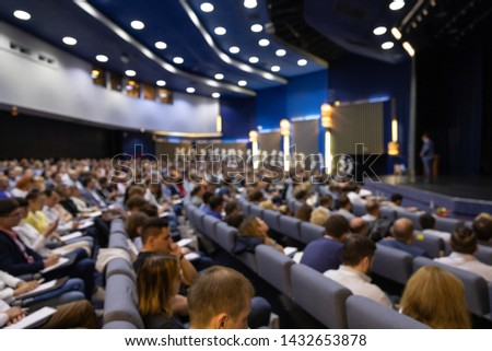 Speaker at Business Conference. Abstract blurred people in press conference event, business concept #1432653878