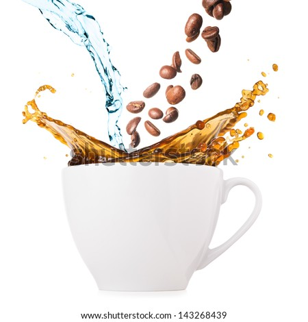 hot coffee is splashing in cup. water and beans are blending #143268439