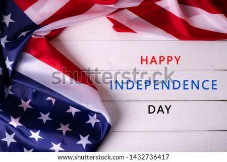 "Flag of the United States of America on wooden background with text ""HAPPY INDEPENDENCE DAY"". USA holiday of Veterans, Memorial, Independence and Labor Day. #1432736417"