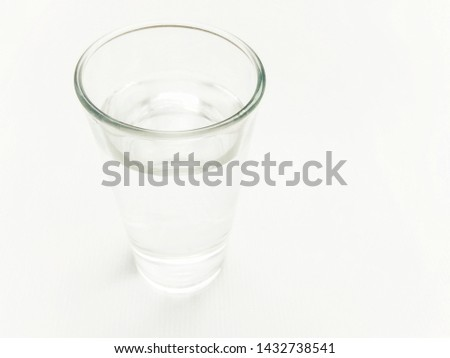 Glass of drinking water isolated on a white background. #1432738541