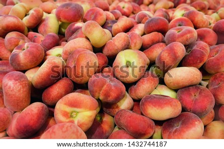 fig flat peaches. juicy ripe fig peaches fruit. red mature fig peaches background, agricultural products, sale in farmers market. Harvest season #1432744187
