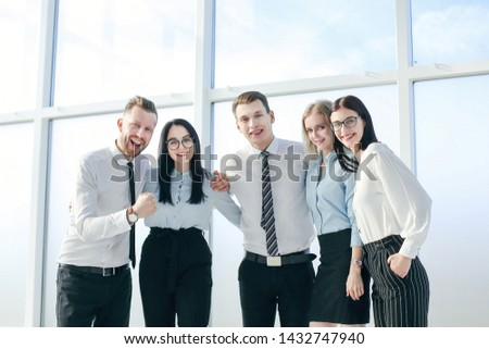successful business team standing near the office window #1432747940