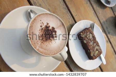 Coffee and brownie on wood table. #1432839707
