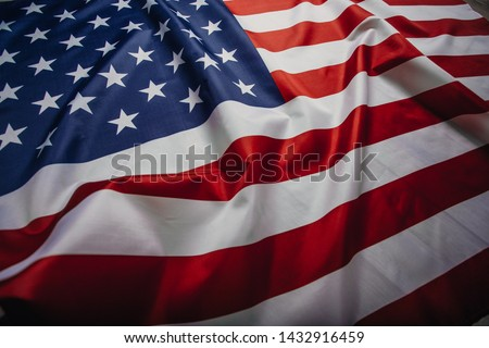 American flag waving in the wind.  #1432916459