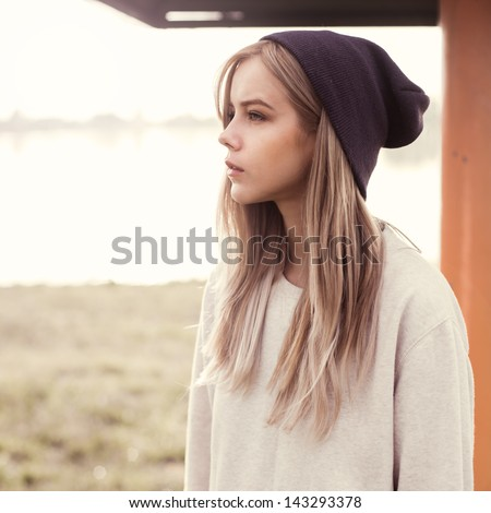 beautiful girl hipster in the morning on the beach