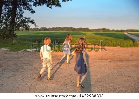 Children are running outdoor. Summer fun. #1432938398