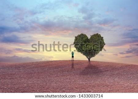 Tree in the shape of heart on a field #1433003714