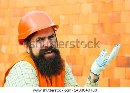 Protest worker. Salary. Unhappy builder. Disturbance. Sad employee. #1433040788