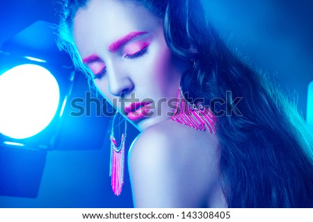 Sexy adult woman with closed eyes and pink make up in studio #143308405