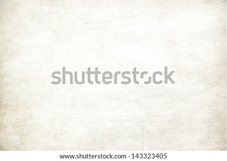 Old vintage paper with a glowing center and grunge vignette. Royalty-Free Stock Photo #143323405