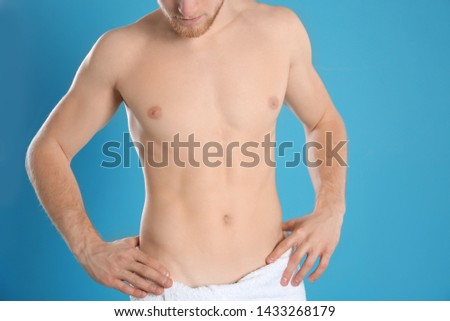 Man with slim body on color background, closeup #1433268179