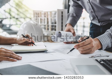 Architecture Engineer Teamwork Meeting, Drawing and working for architectural project and engineering tools on workplace, concept of worksite on technical drawing structure and construction. Royalty-Free Stock Photo #1433283353