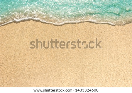 Soft waves with foam of blue ocean on the sandy beach #1433324600