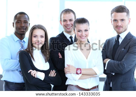 Group portrait of a professional business team looking confidently at camera #143333035