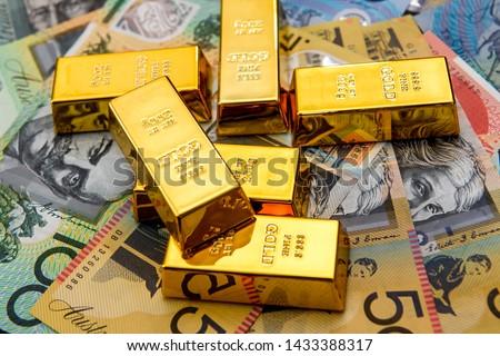 Gold bullion at colorful australian dollar banknotes #1433388317