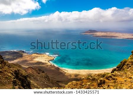 Amazing view of beautiful volcanic island Graciosa - panoramic view near Mirador del rio, Lanzarote. Location: north of Lanzarote, Canary Islands, Spain. Artistic picture. Beauty world.