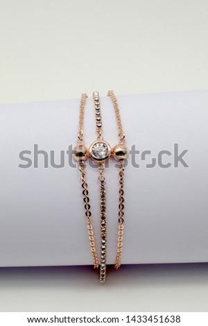 women's gold bracelet on whit background jewelry, gold bracelet with stones, women's jewelry, a girl with a bracelet on her arm, a bracelet with stones #1433451638