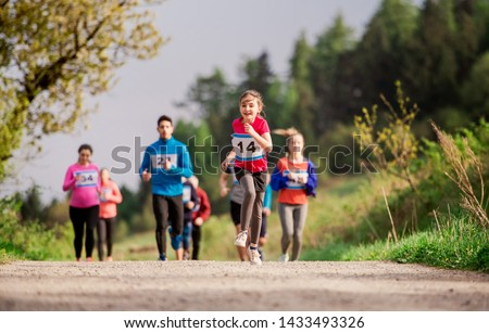 Large group of multi generation people running a race competition in nature. #1433493326