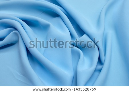 Fabric viscose (rayon). Color is light blue. Texture, background, pattern. #1433528759