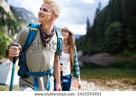 Hiking with friends is so fun. Group of young people with backpacks hiking together #1433593901