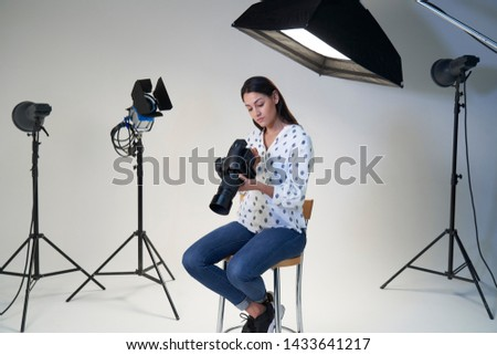 Female Photographer In Studio For Photo Shoot With Camera And Lighting Equipment     #1433641217