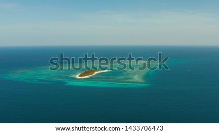 Tropical island on an atoll with beautiful sandy beach by coral reef from above. Canimeran Island and coral reef. Summer and travel vacation concept. #1433706473