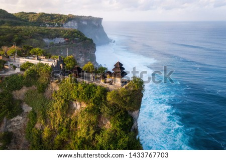 Bali, Indonesia, aerial view of Pura Luhur Uluwatu temple at sunrise. #1433767703
