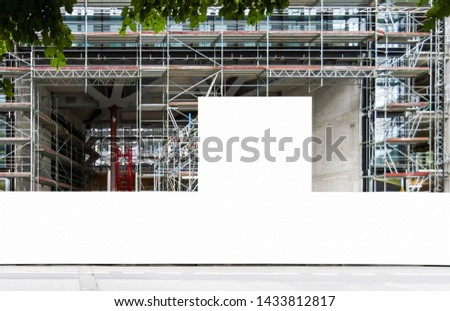 Construction site with blank construction fence mockup, fence panel with copy space for branding or building information  #1433812817