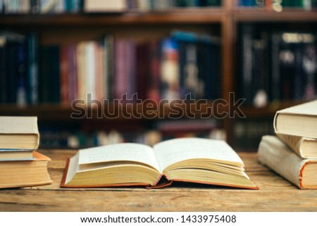 The book in the library (school, university, college) on the table. Reading, literature, learning and back to school concept. Copy space. #1433975408